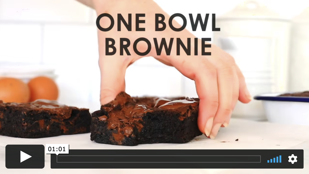 A fudgy brownie on a marble countertop